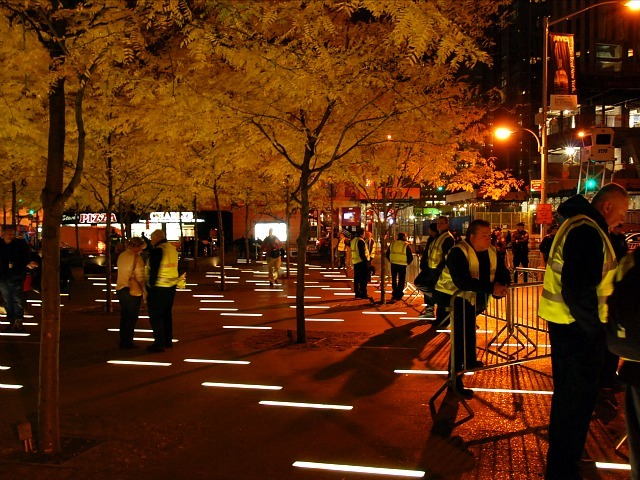 Brookfield Properties employees (in yellow vests) roam a nearly empty Zuccotti Park on Nov. 15, 2011 after the plaza was cleaned.