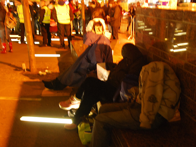 Occupy Wall Street protesters sleep on a bench at Zuccotti Park on Nov. 15, 2011 after they were evicted from the plaza.