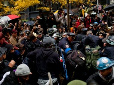 Police officers clash with protesters affiliated with Occupy Wall Street in Zuccotti Park on November 17, 2011 in New York City. The day was marked by sporadic violence, arrests, and injuries sustained by both protesters and police. Protesters attempted to shut down the New York Stock Exchange, blocking roads and tying up traffic in Lower Manhattan.