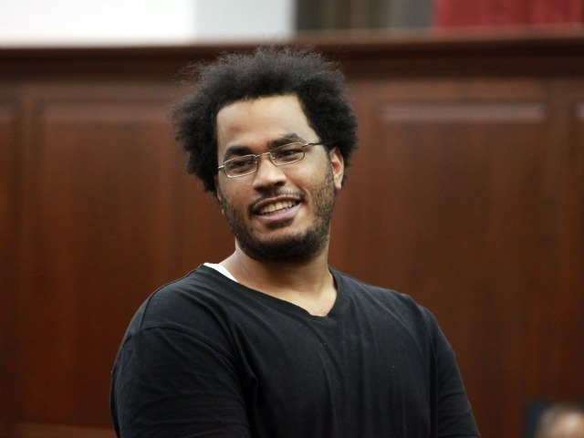 Jose Pimentel cracks a smile during his arraignment in Manhattan Criminal Court Sunday night.