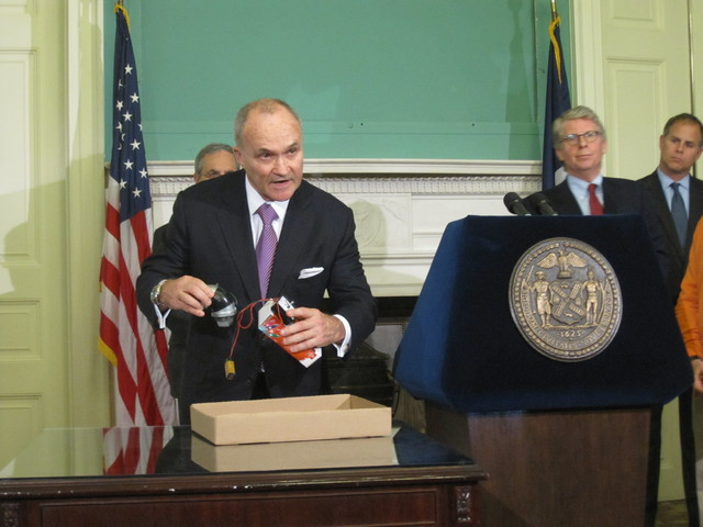 Police Commissioner Ray Kelly shows off a replica of the alleged pipe bombs.