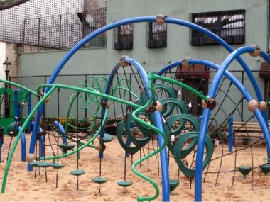 The curvy design of the play equipment is intended to evoke Minetta Brook, the small stream that once passed through the area, a statement on the playground's fence says.