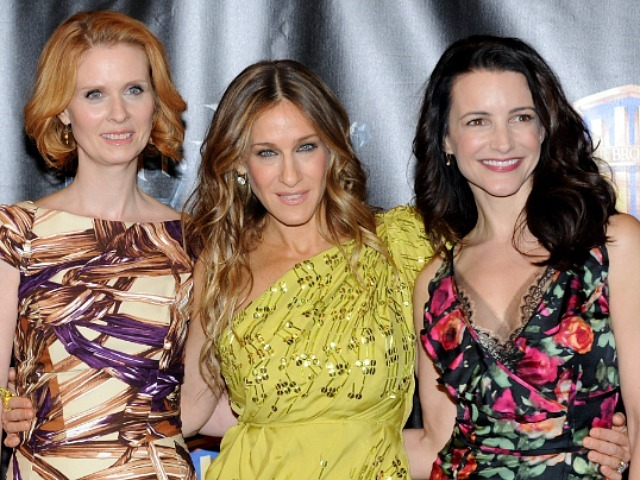 Cynthia Nixon, Sarah Jessica Parker and Kristin Davis pose at a premiere for