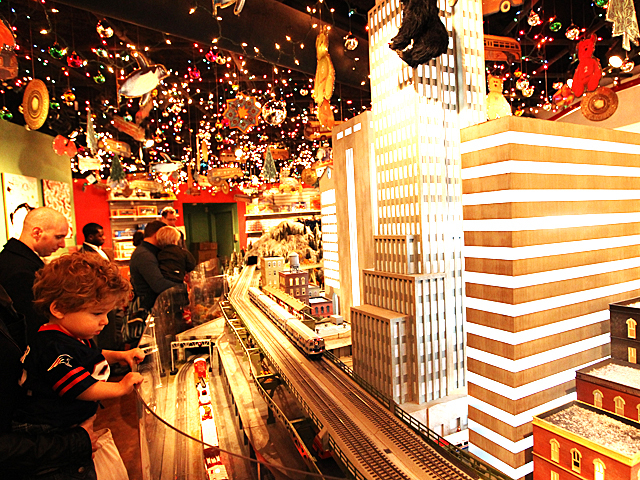 Kids enjoy the Holiday Train Show at Grand Central Terminal over the Thanksgiving weekend, 2011.