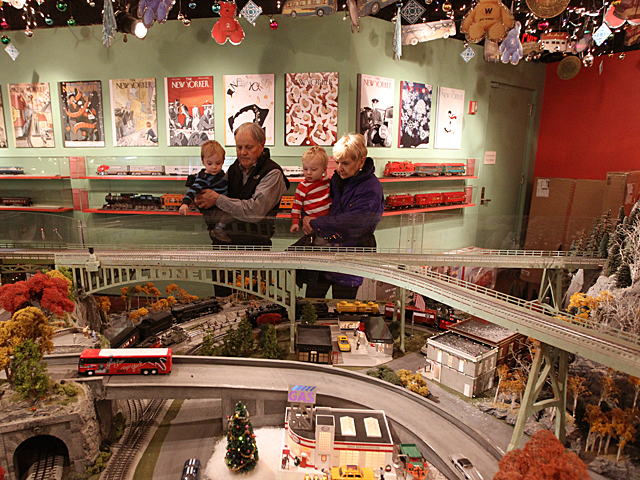 A family enjoys the Holiday Train Show at Grand Central Terminal over the Thanksgiving weekend, 2011.