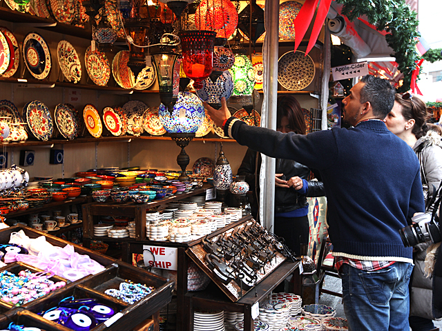 <p>Shoppers look for holiday gifts at the &quot;Tribal Home,&quot; stall at the Union Square Holiday Market on Nov. 27, 2011.</p>