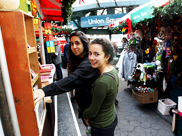 <p>Andrea Mufarreh and pal Ellen Ebert from California look for holiday gifts at Union Square market.</p>