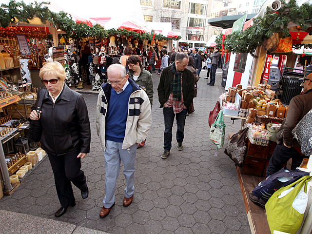 <p>Shoppers look for gifts at the Union Square Holiday Market on Nov. 27, 2011.</p>