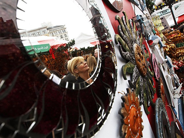 <p>A shopper looks for gifts at the annual Union Square Holiday Market on Nov. 27, 2011.</p>