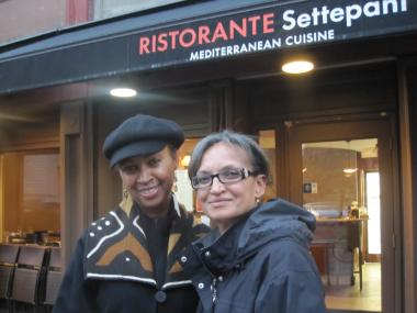 Ristorante Settepani co-owner Leah Abraham (right)  with Syderia Chresfield, resident of the Mount Morris Park Community Improvement Associations. Abraham says a proposal to limit the hours alcohol can be served at Harlem bars and restaurants could hurt business.