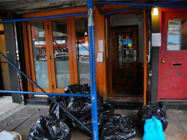 After an extensive cleanup, garbage bags sit outside Hana Sushi on Nov. 28, 2011.