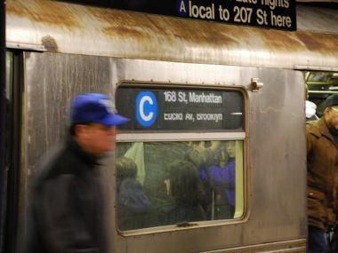 A person landed under the C train at 155th Street and St. Nicholas.