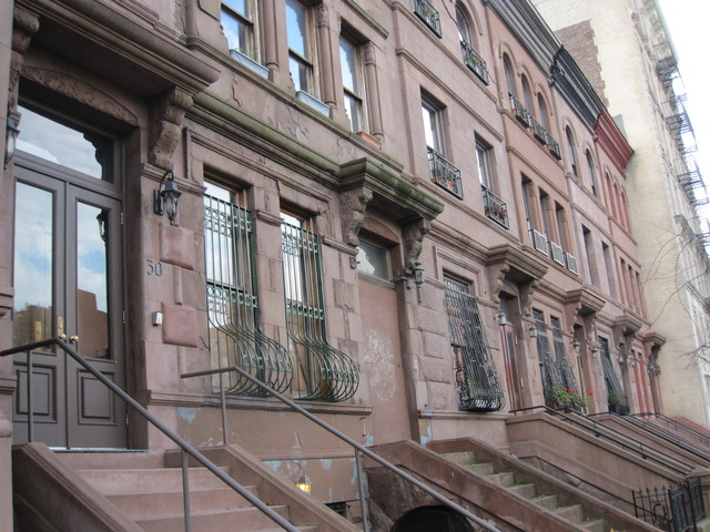 This row of brownstones is located on West 120th Street in the Mount Morris Park Historic District.