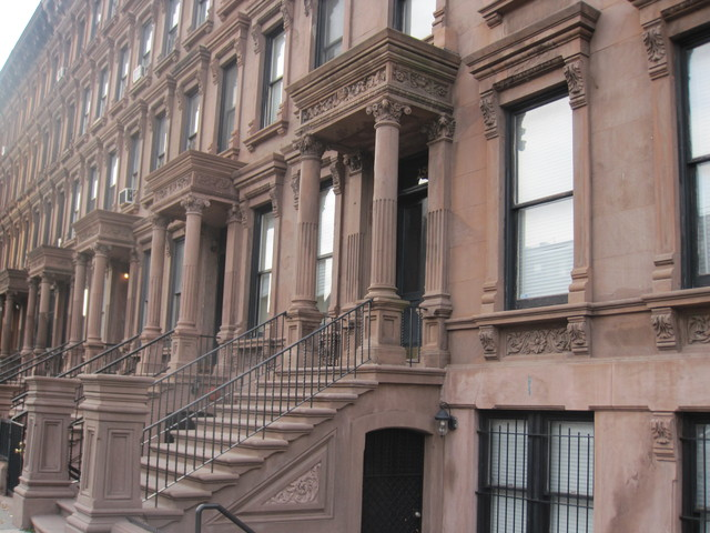 These brownstones are located on Lenox Avenue in the Mount Morris Park historic district.