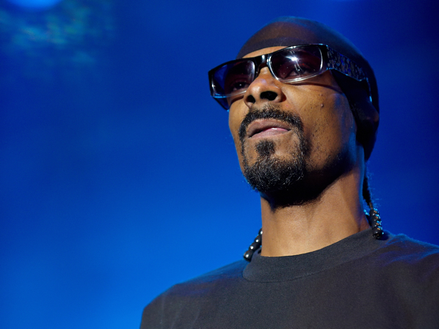 A smoking' lineup at Terminal 5. Sunday. Snoop Dogg (pictured) & Wiz Khalifa get together to cook up some mischief.