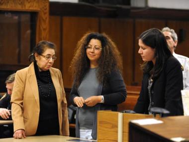 Beatriz Rios (center), 46, is arraigned in Manhattan Criminal Court on Dec. 1, 2011.