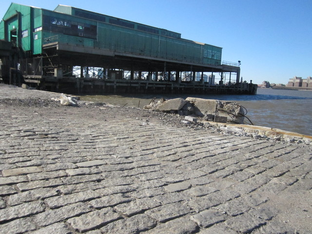 <p>A section of the old 13th Avenue is visible on Pier 52 at Gansevoort Street, which could eventually become a beach.</p>