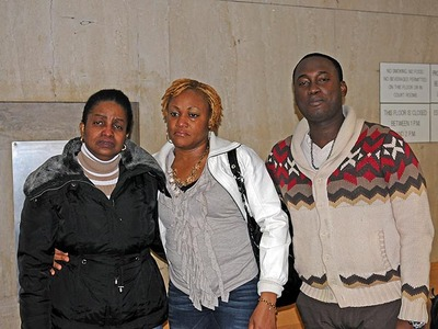 Rayon McIntosh's mother, Maureen Lucas, girlfriend, Althea Bartley and brother-in-law Delmor Wilson, weep tears of joy on Dec. 2, 2011, outside the Manhattan courtroom where Rayon McIntosh was cleared of charges in the McDonald's beating case.