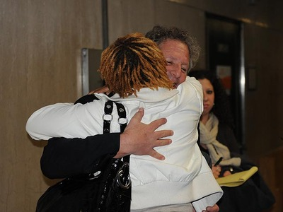 Rayon McIntosh's girlfriend, Althea Bartley, hugs his lawyer, Theodore Herlich, in Manhattan Supreme Court on Dec. 2, 2011 after the charges against McIntosh in the McDonald's beating case were dropped.
