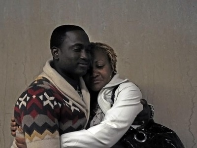 Rayon McIntosh's girlfriend, Althea Bartley (right) hugs his brother-in-law Delmor Wilson in Manhattan Supreme Court on Dec. 2, 2011 after the charges against McIntosh in the McDonald's beating case were dismissed.