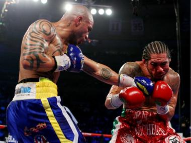 Miguel Cotto (L) of Puerto Rico connects with a left handed punch against Antonio Margarito of Mexico during the WBA World Junior Middleweight Title fight at Madison Square Garden on December 3, 2011 in New York City.
