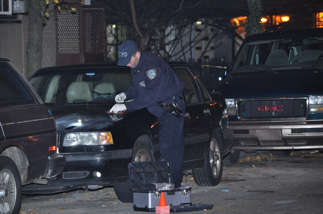 Police investigate a shooting outside 120 W. 94th St. late Sun., Dec. 4, 2011.