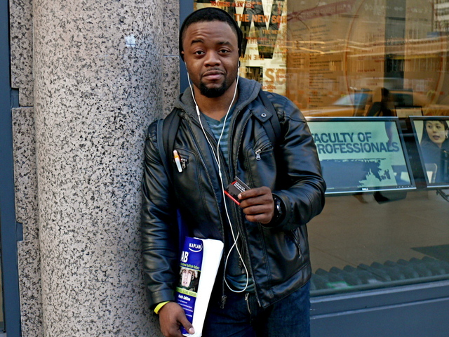 Terrell D. in quilted biker style jacket with hoodie and knitted cap on Fifth Avenue.