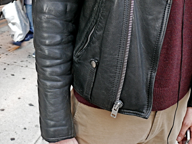 Belt loop and zipper details on the well burnished jacket, worn by Andrew H., Soho.