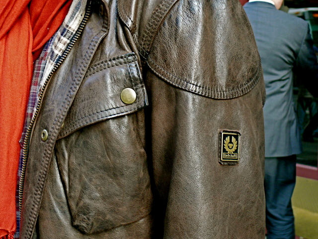 Details of Dushan K. in a very British Belstaff jacket in brown distressed leather.