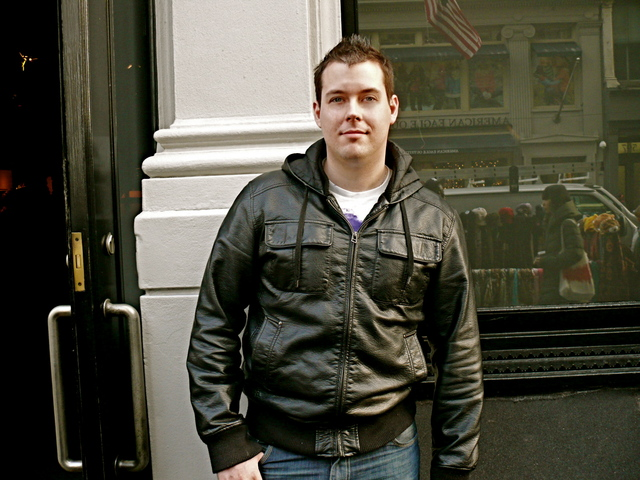 James R. in a bomber style jacket with cropped spiked hair.