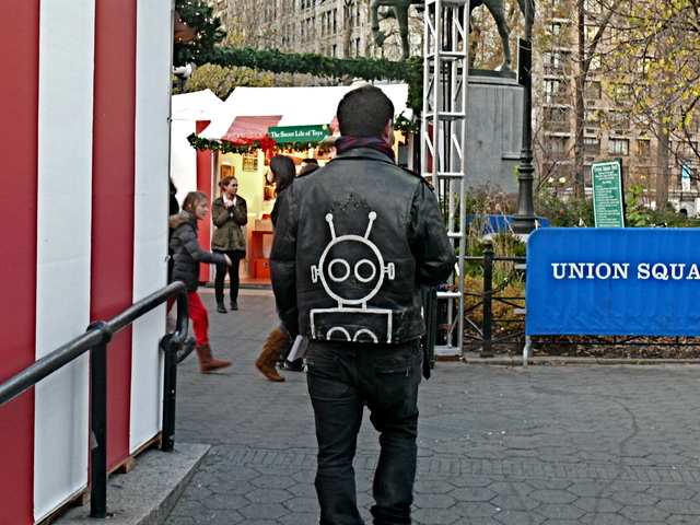 A fashion mis-step: a square, old-school gusset sleeve biker with club kid details in Union Square is defintely not on trend, and not the current biker jacket look.
