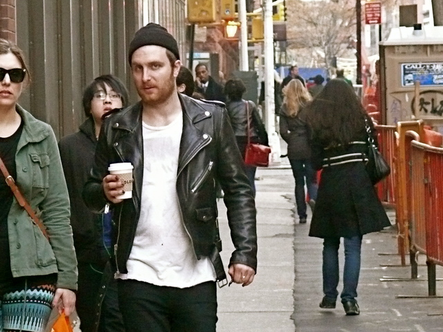 A wide neck t-shirt, knitted hat and fitted biker jacket in Washington Square East.
