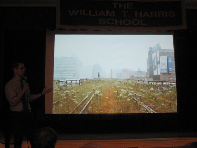 Friends of the High Line co-founder Robert Hammond shows off a photo of the currently-closed third section of the High Line at a meeting on Dec. 6, 2011.