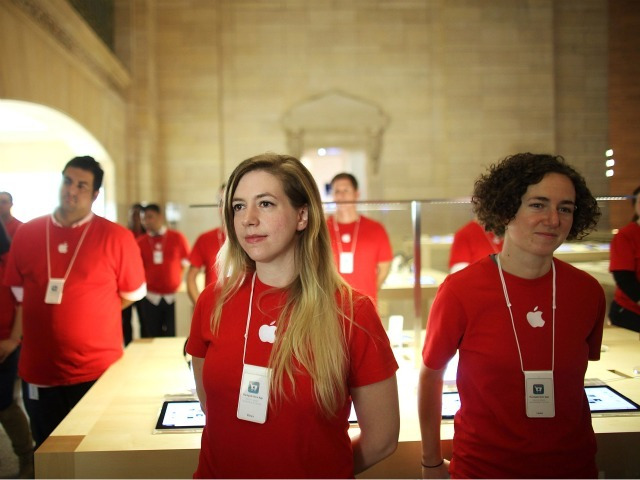 Employees stand in the new Apple store in Grand Central Terminal.