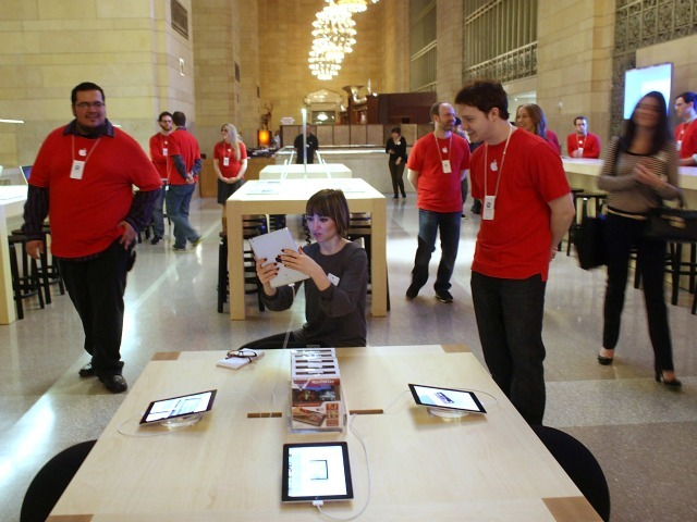 Employees get ready for the opening of the Apple Store in Grand Central Terminal. The store is set to open Friday, Dec. 9.