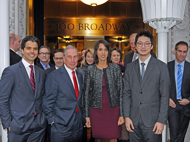Mayor Bloomberg poses with the Urban Umbrellas designers, Andres, Cortes, Sarrah Khan and Young-Hwan Choi (left to right), Dec. 7, 2011.