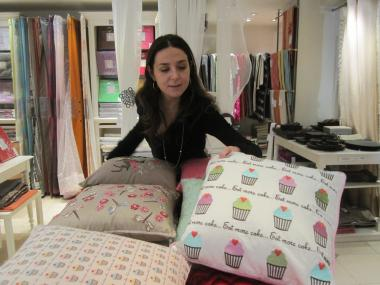 Maja Efendic fixes the pillows at Madura on Madison Avenue.