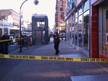 Police investigate a shooting at the 125th Street station on the A, B, C and D lines on Dec. 9, 2011.