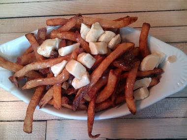 The currently location of Mile End serves poutine — french fries covered in gravy and cheese curds.