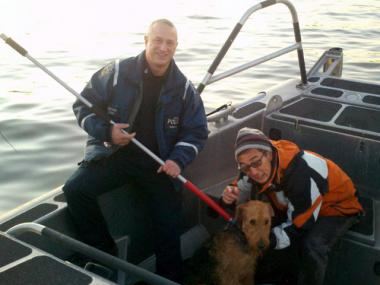 Officer Kevin Fedynak with the Airedale Terrier and its owner after saving the dog from drowning in the Hudson River on Dec. 11, 2011.