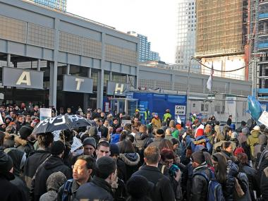 Occupy Wall Street protesters get tangled with Monday morning commuters outside the World Trade Center PATH station on Dec. 12, 2011.