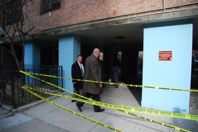 Police officials investigate a shooting and stabbing at the Fulton Houses, next to Chelsea Market.