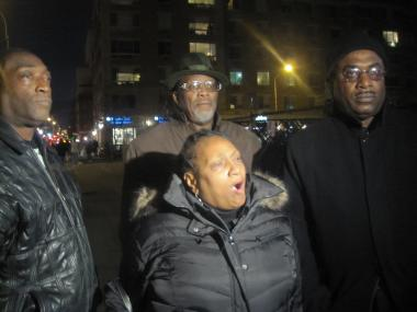Harlem anti-violence advocates, including Jackie Rowe-Adams, co-founder of Harlem Mothers S.A.V.E, and Rev. Vernon Williams, president of the Harlem Clergy Community Leaders Coalition and Perfect Peace Ministries (front row) gathered near where a woman was shot in the abdomen Sun., Dec. 10, 2011.