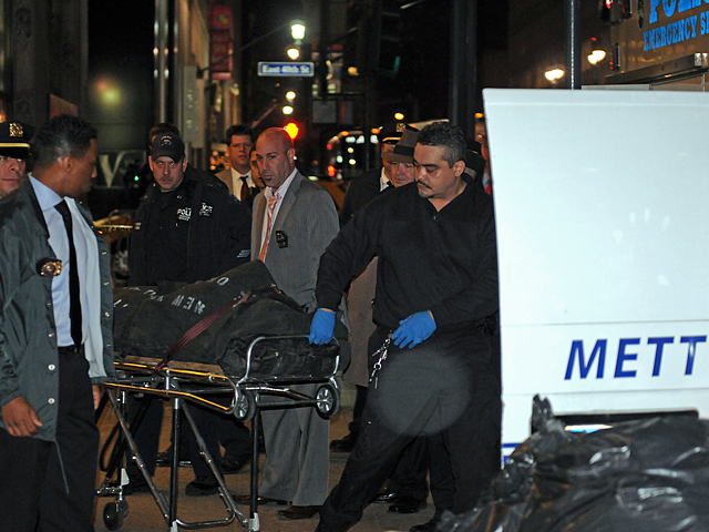 <p>Suzanne Hart&#39;s body is brought out of 285 Madison Avenue after she was killed in an elevator accident, Dec. 14, 2011.</p>