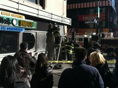 The facade of the Tick Tock Diner on 34th Street and Eighth Avenue caught fire on Dec. 18, 2011.