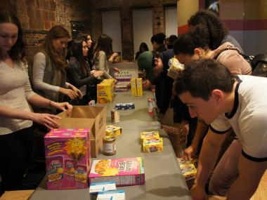Volunteers prepare boxes for elderly Jewish residents of the Lower East Side before Hanukkah .