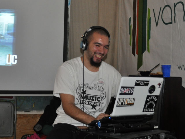 DJ Boy played music at the Word Up Rent Party Saturday, Dec. 17, 2011.