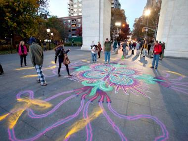 Street artist Joe Mangrum makes sand paintings in public areas including Washington Square Park.