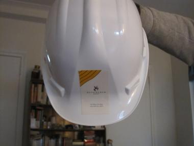 Resident Barbara Wagner said she was given this hard hat to protect her from dangling wires as she walks into and out of the building,