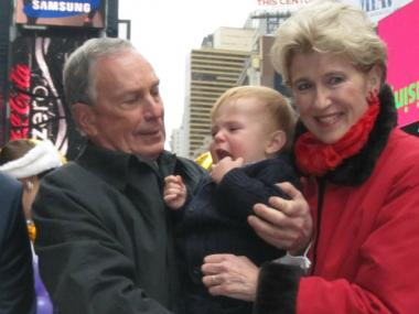 Mayor Michael Bloomberg looked more than a little awkward holding one-year-old Thomas Johnson at the announcement Tuesday.